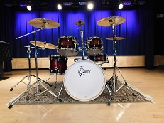 Drumset situated on a stage